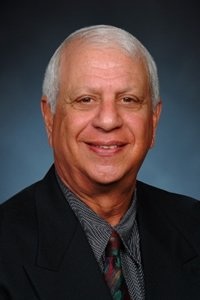 John W. Meshad -Retired meshad 200x300 0